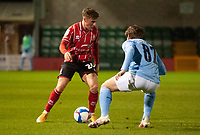 Lincoln City's Robbie Gotts vies for possession with Manchester City U21's Adrian Berbnabe<br /> <br /> Photographer Andrew Vaughan/CameraSport<br /> <br /> EFL Papa John's Trophy - Northern Section - Group E - Lincoln City v Manchester City U21 - Tuesday 17th November 2020 - LNER Stadium - Lincoln<br />  <br /> World Copyright © 2020 CameraSport. All rights reserved. 43 Linden Ave. Countesthorpe. Leicester. England. LE8 5PG - Tel: +44 (0) 116 277 4147 - admin@camerasport.com - www.camerasport.com