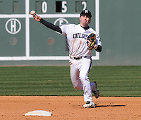 Shortstop Trevor Stevens (3) of the Northwestern Wildcats throws out a runner in a game against the Michigan State Spartans on Sunday, February 17, 2013, at Fluor Field at the West End in Greenville, South Carolina. Michigan State won, 7-4. (Tom Priddy/Four Seam Images)