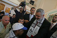 """Deposed Palestinian Authority Prime Minister Ismail Haniyeh, center, is seen during a public relations tour organized by the Islamic group Hamas for local and foreign journalists in Gaza City, Monday, July 30 2007.""""photo by Fady Adwan"""""""