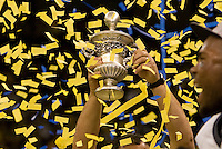 Michigan head coach Brady Hoke holds up Sugar Bowl trophy after winning Sugar Bowl game against Virginia Tech at Mercedes-Benz SuperDome in New Orleans, Louisiana on January 3rd, 2012.  Michigan defeated Virginia Tech, 23-20 in first overtime.