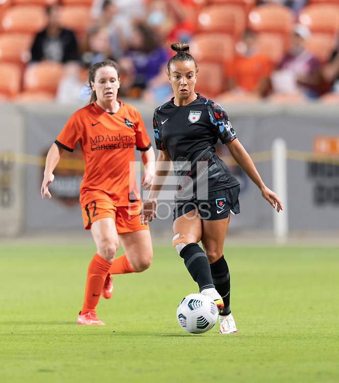 HOUSTON, TX - SEPTEMBER 10: Mallory Pugh #9 of the Chicago Red Stars passes the ball in front of Allysha Chapman #2 of the Houston Dash during a game between Chicago Red Stars and Houston Dash at BBVA Stadium on September 10, 2021 in Houston, Texas.