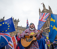 A young lady sings - BREXIT scenes in Westminster Houses of Parliament and surrounding area, London, England on 16 January 2019. Photo by Andy Rowland.