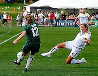Los Angeles Sol midfielder Aly Wagner (4) dives and knocks the ball away from St Louis Athletica Elise Weber (12) during a WPS match at Hermann Stadium, in St. Louis, MO, April 25 2009. The match ended in a 0-0 tie.