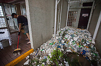 Residents clean their doorstep of marine debris and plastics pollution on a public housing estate during the aftermath of the passing of Typhoon Hato, Heng Fa Chuen, Hong Kong, China, 23 August 2017.<br /> ALEX HOFFORD
