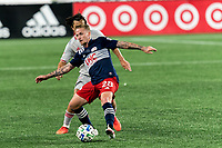 FOXBOROUGH, MA - AUGUST 29: Alexander Buttner #28 of New England Revolution attempts to control the ball as Cristian Casseres Jr #23 of New York Red Bulls pressures during a game between New York Red Bulls and New England Revolution at Gillette Stadium on August 29, 2020 in Foxborough, Massachusetts.