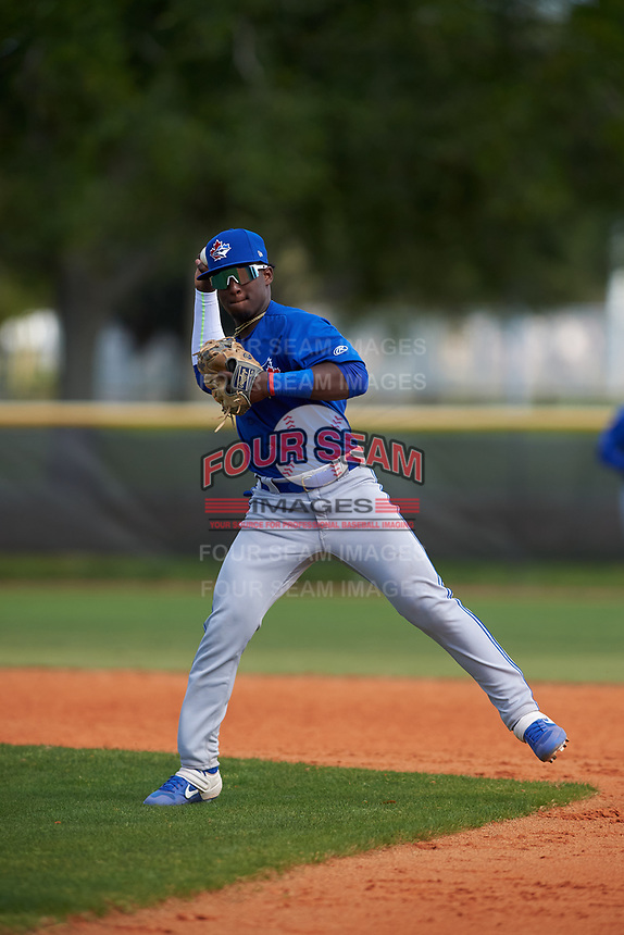Toronto Blue Jays Estiven Machado (68) throws to first base during an exhibition game against the Canada Junior National Team on March 8, 2020 at Baseball City in St. Petersburg, Florida.  (Mike Janes/Four Seam Images)