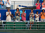 Michelle Obama and daughters Malia (striped shirt) and Sasha(white tee, looking down) attend the World Team Tennis match between the Washington Kastles and the Boston Lobsters on July 16, 2012 in Washington, DC.
