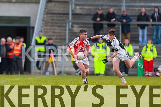 Mike Finnegan Brosna is tackled by Glin's Kevin Sweeney during the Munster junior final in mallow on Sunday