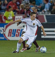 Real Salt Lake midfielder Will Johnson (white) turns the ball away from Omar Cummings. Real Salt Lake earned a tied versus the Colorado Rapids securing a place in the postseason. Dick's Sporting Goods Park, Denver, Colorado, October, 25, 2008. Photo by Trent Davol/isiphotos.com
