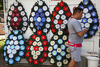 Romania. Iași County. Iasi. Town center. A man dressed with casual clothes is using his mobile phone while standing close to a shop selling colorful funeral wreaths. Iași (also referred to as Iasi, Jassy or Iassy) is the largest city in eastern Romania and the seat of Iași County. Located in the Moldavia region, Iași has traditionally been one of the leading centres of Romanian social life. The city was the capital of the Principality of Moldavia from 1564 to 1859, then of the United Principalities from 1859 to 1862, and the capital of Romania from 1916 to 1918. 10.06.15 © 2015 Didier Ruef
