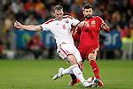 Spain's Gerard Pique (r) and Belarus' Sergei Kornilenko during 15th UEFA European Championship Qualifying Round match. November 15,2014.(ALTERPHOTOS/Acero)