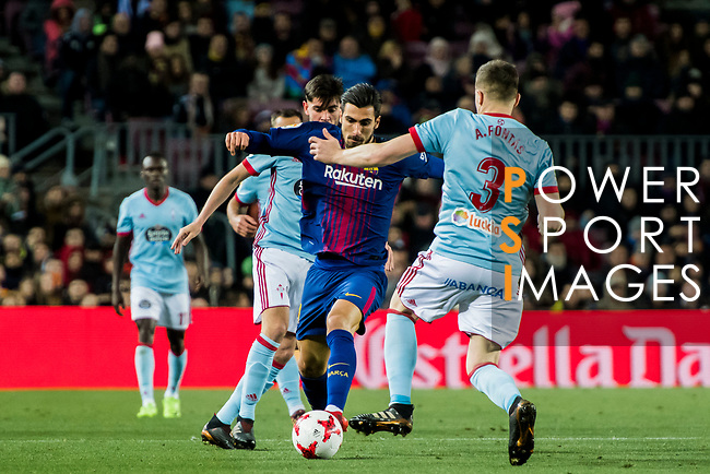 Andre Filipe Tavares Gomes (C) of FC Barcelona fights for the ball with Andreu Fontas Prat (R) of RC Celta de Vigo  during the Copa Del Rey 2017-18 Round of 16 (2nd leg) match between FC Barcelona and RC Celta de Vigo at Camp Nou on 11 January 2018 in Barcelona, Spain. Photo by Vicens Gimenez / Power Sport Images