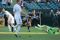 Chris Wondolowski (center) scores the goal against Joe Cannon (right). The San Jose Earthquakes tied the Vancouver Whitecaps 2-2 at Buck Shaw Stadium in Santa Clara, California on July 20th, 2011.