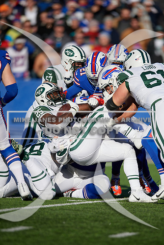 New York Jets running back Elijah McGuire (25) is tackled during an NFL football game against the Buffalo Bills, Sunday, December 9, 2018, in Orchard Park, N.Y.  (Mike Janes Photography)