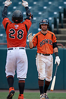 Bowie Baysox Mason McCoy (5) congratulates Brett Cumberland (28) after a home run during an Eastern League game against the Binghamton Rumble Ponies on August 21, 2019 at Prince George's Stadium in Bowie, Maryland.  Bowie defeated Binghamton 7-6 in ten innings.  (Mike Janes/Four Seam Images)