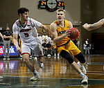 SIOUX FALLS, SD - MARCH 8: Sam Griesel #5 of the North Dakota State Bison drives the lane past Kruz Perrott-Hunt #5 of the South Dakota Coyotes during the Summit League Basketball Tournament at the Sanford Pentagon in Sioux Falls, SD. (Photo by Dave Eggen/Inertia)