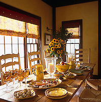 This table is laid for a country-style lunch and and the cheery sunflowers and patterned crockery add to the sense of endless sunshine