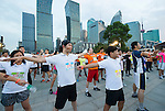 Warm-up before the race at the Bloomberg Square Mile Relay near the Huangpu River in Shanghai, China. Photo by Lucas Schifres / Power Sport Images