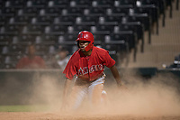 AZL Angels designated hitter Jose Verrier (4) after sliding across home plate during an Arizona League game against the AZL Diamondbacks at Tempe Diablo Stadium on June 27, 2018 in Tempe, Arizona. The AZL Angels defeated the AZL Diamondbacks 5-3. (Zachary Lucy/Four Seam Images)