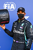 26th September 2020, Sochi, Russia; FIA Formula One Grand Prix of Russia, qualification;  44 Lewis Hamilton GBR, Mercedes-AMG Petronas Formula One Team celebrates as he takes pole