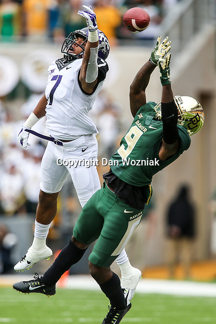 Baylor Bears wide receiver KD Cannon (9) and TCU Horned Frogs safety George Baltimore (7) in action during the game between the TCU Horned Frogs and the Baylor Bears at the McLane Stadium in Waco, Texas. TCU leads Baylor 31 to 27 at halftime.