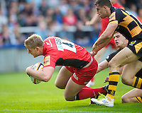 130712 Copyright onEdition 2012 ©.Free for editorial use image, please credit: onEdition..George Kruis of Saracens dives over to score a try against London Wasps at The Stoop, Twickenham in the first round of The J.P. Morgan Asset Management Premiership Rugby 7s Series...The J.P. Morgan Asset Management Premiership Rugby 7s Series kicked off again for the third season on Friday 13th July at The Stoop, Twickenham with Pool B being played at Edgeley Park, Stockport on Friday, 20th July, Pool C at Kingsholm Gloucester on Thursday, 26th July and the Final being played at The Recreation Ground, Bath on Friday 3rd August. The innovative tournament, which involves all 12 Premiership Rugby clubs, offers a fantastic platform for some of the country's finest young athletes to be exposed to the excitement, pressures and skills required to compete at an elite level...The 12 Premiership Rugby clubs are divided into three groups for the tournament, with the winner and runner up of each regional event going through to the Final. There are six games each evening, with each match consisting of two 7 minute halves with a 2 minute break at half time...For additional images please go to: http://www.w-w-i.com/jp_morgan_premiership_sevens/..For press contacts contact: Beth Begg at brandRapport on D: +44 (0)20 7932 5813 M: +44 (0)7900 88231 E: BBegg@brand-rapport.com..If you require a higher resolution image or you have any other onEdition photographic enquiries, please contact onEdition on 0845 900 2 900 or email info@onEdition.com.This image is copyright the onEdition 2012©..This image has been supplied by onEdition and must be credited onEdition. The author is asserting his full Moral rights in relation to the publication of this image. Rights for onward transmission of any image or file is not granted or implied. Changing or deleting Copyright information is illegal as specified in the Copyright, Design and Patents Act 1988. If you are in any way unsure of your right to publish this i