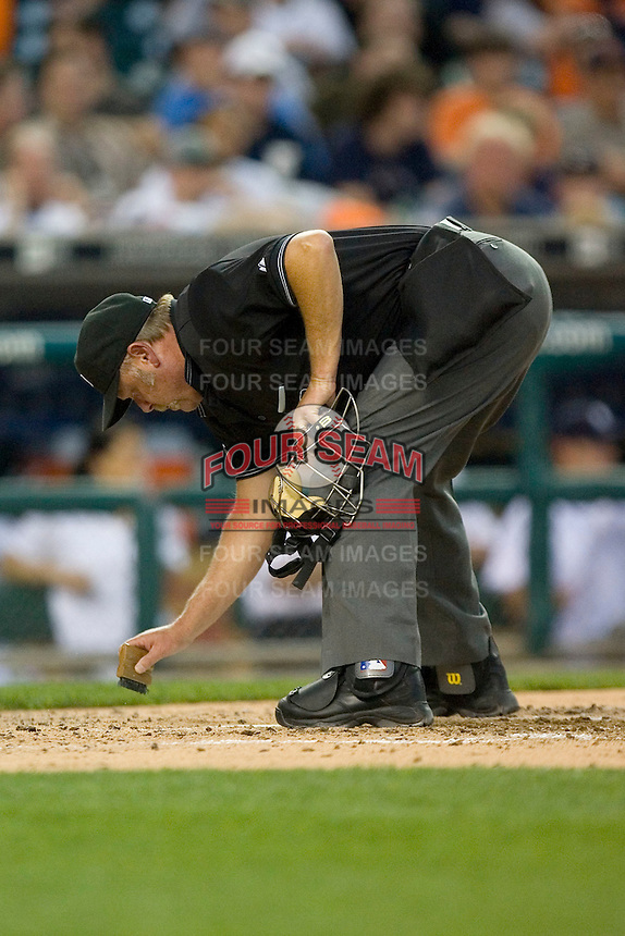 Umpire Jim Joyce cleans off home plate at Comerica Park April 27, 2009 in Detroit, Michigan.  Photo by Brian Westerholt / Four Seam Images