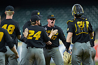 Missouri Tigers relief pitcher Trey Dillard (47) celebrates with his teammates after getting the final out in the game against the Texas Longhorns in game eight of the 2020 Shriners Hospitals for Children College Classic at Minute Maid Park on March 1, 2020 in Houston, Texas. The Tigers defeated the Longhorns 9-8. (Brian Westerholt/Four Seam Images)