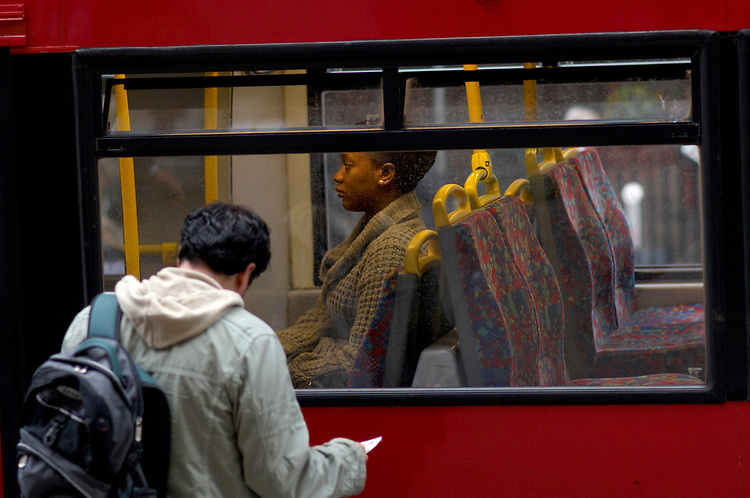 © John Angerson <br /> Passengers on London Bus route near Liverpool Street.<br /> <br /> +44 (0) 7767 822828