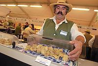 - truffle market in Alba, white truffles seller....- mercato dei tartufi ad Alba, venditore di tartufi bianchi