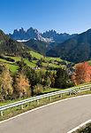 Italy, South Tyrol, Alto Adige, Dolomites, Val di Funes: mountain village St. Magdalena and Le Odle mountains at natural park Puez-Odle, rural road
