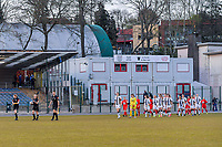 players enter the field pictured before a female soccer game between FC Femina White Star Woluwe and Sporting Charleroi on the 2nd matchday of Play off 2 in  the 2020 - 2021 season of Belgian Scooore Womens Super League , friday 16 th of April 2021  in Woluwe , Belgium . PHOTO SPORTPIX.BE   SPP   STIJN AUDOOREN
