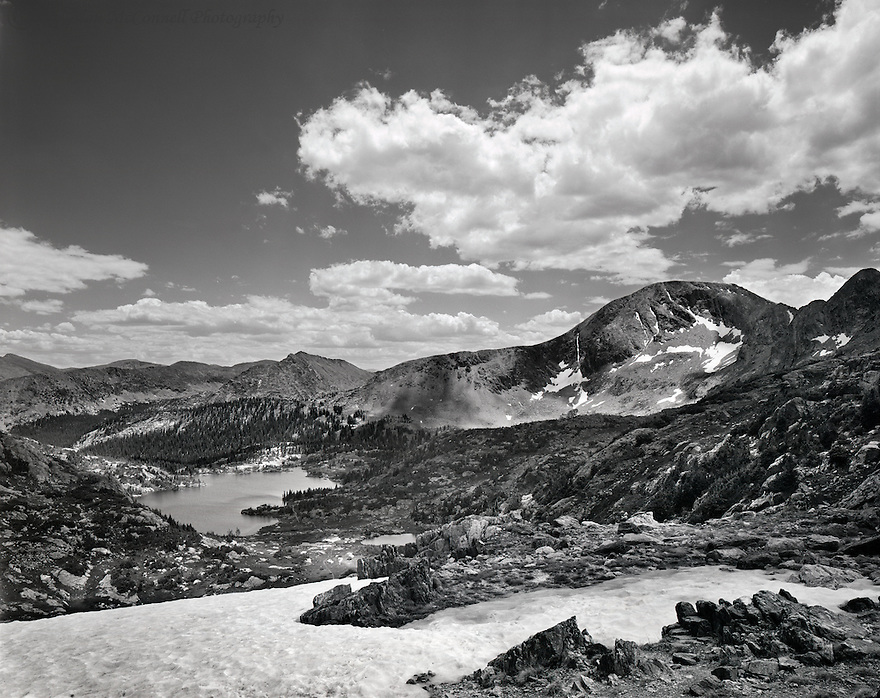 """""""Atop Missouri Pass""""<br /> Holy Cross Wilderness, Colorado<br />  2013<br /> <br /> After hiking four miles from the trailhead and gaining about 2000 feet, I am rewarded with this view from the top of Missouri Pass.  The view back down the trail encompasses the basin containing the Missouri Lakes and Savage Peak to the right.  This spot provides a nice place to pause and regain your breath in the thin air. <br /> <br /> 4 x 5 Large Format Film"""