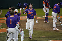 Matthew Lumsden (47) of the Clemson Tigers is greeted after hitting a two-run home run in a fall Orange-Purple intrasquad scrimmage on Friday, November 13, 2020, at Doug Kingsmore Stadium in Clemson, South Carolina. (Tom Priddy/Four Seam Images)