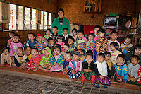 Myanmar, Burma.  Pre-School Children, Inle Lake Village, Shan State.  Some are wearing thanaka paste on their faces, a cosmetic sunscreen.