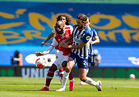 20th June 2020, American Express Stadium, Brighton, Sussex, England; Premier League football, Brighton versus Arsenal ;  Arsenals Alexandre Lacazette is challenged by Brighton and Hove Albions Davy Propper