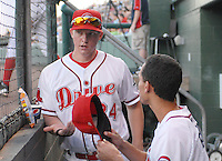 Ryan Westmoreland (24) of the Greenville Drive talks Derrik Gibson in the dugout at a game on Sept. 5, 2010, at Fluor Field at the West End in Greenville, S.C. Westmoreland, once a Top 10 prospect in the Red Sox organiztion, had surgery in March to remove a cavernous malformation on his brain stem, and faces a difficult recovery. He is not yet playing, but is working out with the Drive as part of his rehabilitation. Photo by: Tom Priddy/Four Seam Images