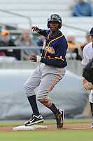 Montgomery Biscuits Tim Beckham #22 pops up after sliding into third during a game against  the Tennessee Smokies at Smokies Park in Kodak,  Tennessee;  April 13, 2011.  Tennessee defeated Montgomery 12-2.  Photo By Tony Farlow/Four Seam Images