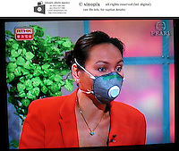 Newsreaders and guests in Hong Kong wear protective masks during a news programe in Hong Kong. There is growing concern over the Sars virus that has spread around the world from China with Hong Kong being the worst hit.