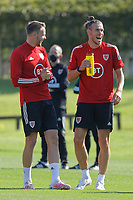 Pictured L-R: Chris Gunter and Gareth Bale share a joke. Monday 31 August 2020<br /> Re: Wales football training ahead of their game against Finland, at the Vale Resort in Hensol, Wales, UK.