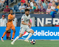 FOXBOROUGH, MA - JUNE 29: Carles Gil #22 on the attack during a game between Houston Dynamo and New England Revolution at Gillette Stadium on June 29, 2019 in Foxborough, Massachusetts.