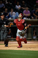 Chattanooga Lookouts catcher Chris Okey (19) and umpire Matthew Brown get in position for a foul ball popup during a Southern League game against the Birmingham Barons on May 1, 2019 at Regions Field in Birmingham, Alabama.  Chattanooga defeated Birmingham 5-0.  (Mike Janes/Four Seam Images)