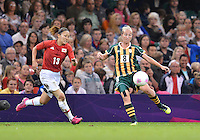 July 31, 2012..Japan's Karina Maruyama (8) and South Africa's Kylie Louw (8) in action during Group F women's Football match between JPN and RSA at the Millennium Stadium on day four of 2012 Olympic Games in Cardiff, United Kingdom...