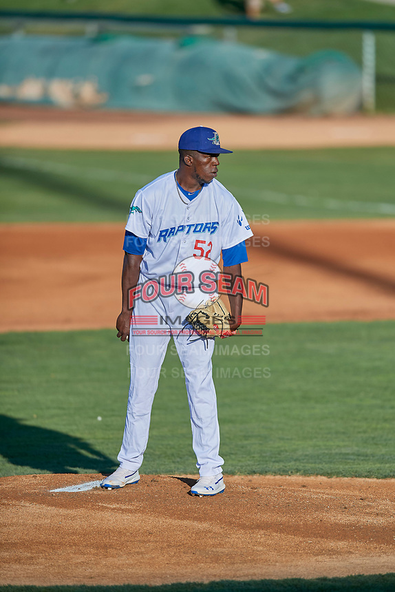 Ogden Raptors starting pitcher Jeronimo Castro (52) looks to home for the sign against the Missoula Osprey at Lindquist Field on August 12, 2019 in Ogden, Utah. The Raptors defeated the Osprey 4-3. (Stephen Smith/Four Seam Images)