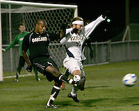 Adam Brent (5) of Oakland boots the ball away from Joseph Iapira (10) of Notre Dame. The University of Notre Dame defeated Oakland University 2-1 in the second round of the NCAA championship at Alumni Field at the University of Notre Dame in South Bend, Indiana on November 28, 2007.