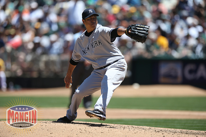 OAKLAND, CA - JUNE 13:  Hiroki Kuroda #18 of the New York Yankees pitches against the Oakland Athletics during the game at O.co Coliseum on Thursday June 13, 2013 in Oakland, California. Photo by Brad Mangin