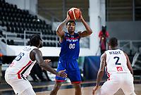 22nd February 2021, Podgorica, Montenegro; Eurobasket International Basketball qualification for the 2022 European Championships, England versus France;  Ovie Soko of Great Britain jump shot over Amath M'Baye (FRA)