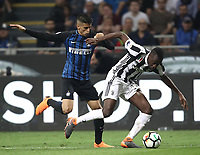 Calcio, Serie A: Inter - Juventus, Milano, stadio Giuseppe Meazza (San Siro), 28 aprile 2018.<br /> Juventus' Blaise Matuidi (r) in action with Inter's Joao Cancelo (l) during the Italian Serie A football match between Inter Milan and Juventus at Giuseppe Meazza (San Siro) stadium, April 28, 2018.<br /> UPDATE IMAGES PRESS/Isabella Bonotto