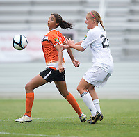 Gloria Douglas (7) of the Charlotte Lady Eagles shields the ball away from Kelly Eagan (20) of the Long Island Rough Riders during the game at the Maryland SoccerPlex in Boyds, Maryland.  The Charlotte Lady eagles defeated the Long Island Rough Riders, 4-0, to advance to the W-League Eastern Conference Championship.