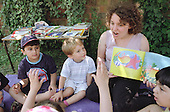 Karen Robinson, Literacy Development Worker for Queen's Park, reads a story to children at Emmanuel Playgroup in the Lydford Estate Tenants' Hall, North Paddington, London.
